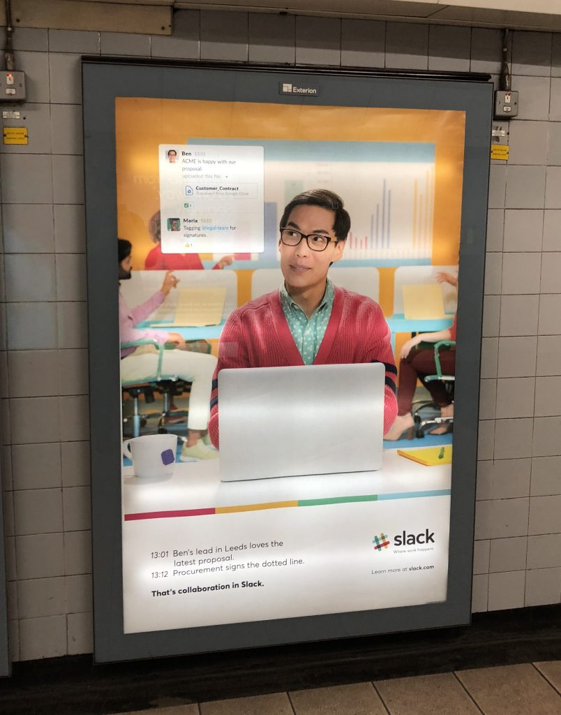 Slack outdoor advertising poster localised campaign tube station