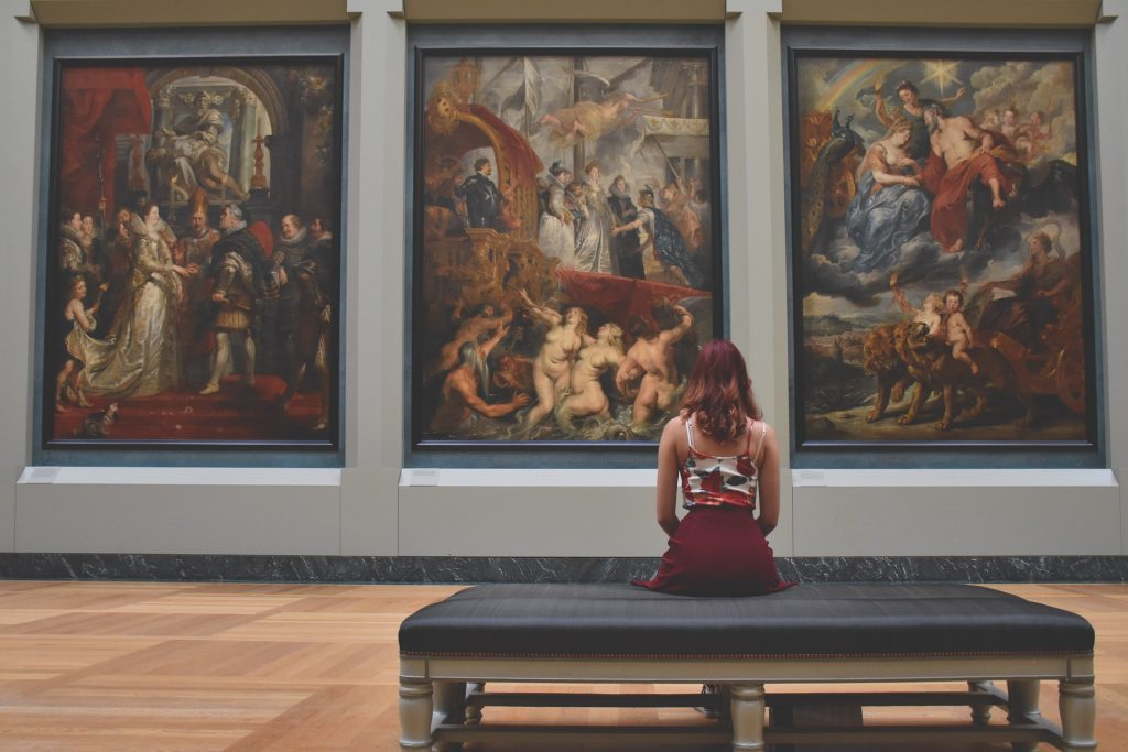 woman sitting in art museum
