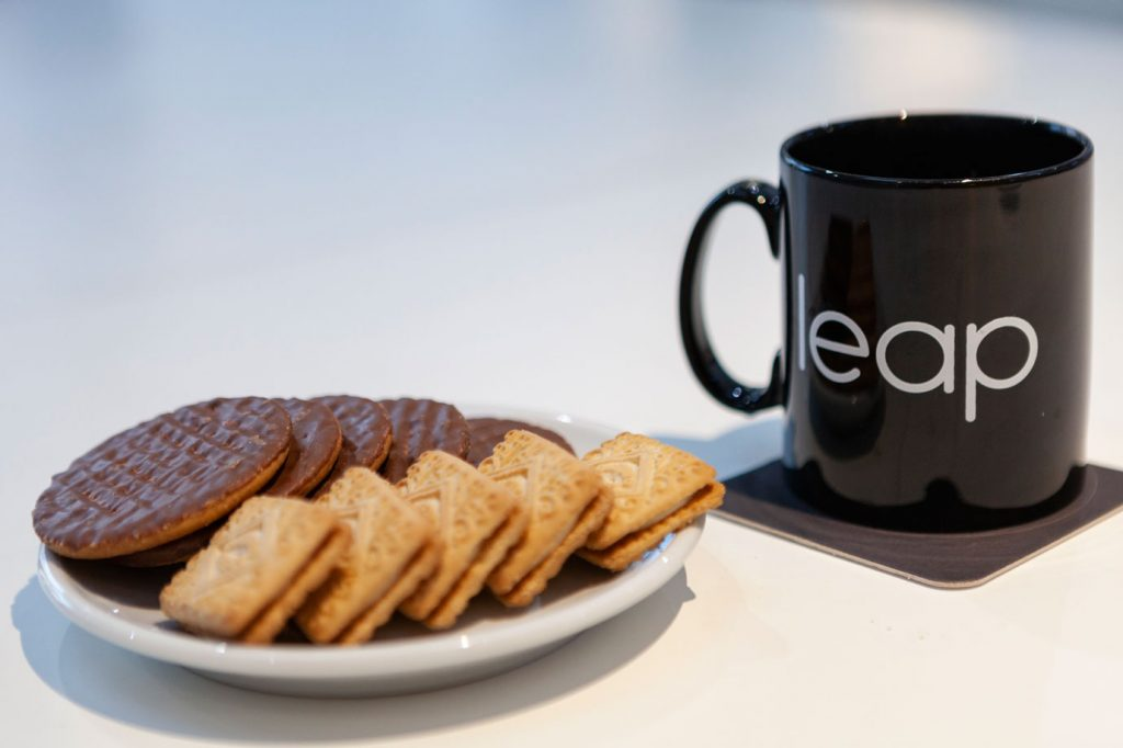 leap mug and plate of biscuits