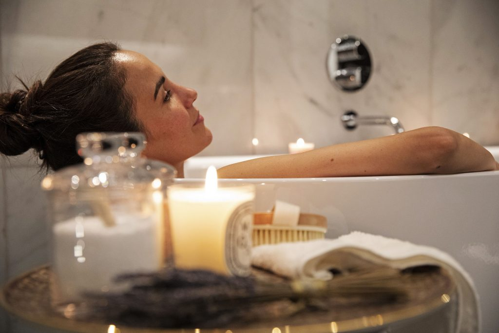 Woman relaxing in bath Luxury Brand Film for the Mansion Marylebone by Clivedale London