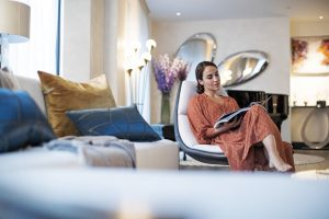 Woman relaxing in lounge Luxury Brand Film for the Mansion Marylebone by Clivedale London