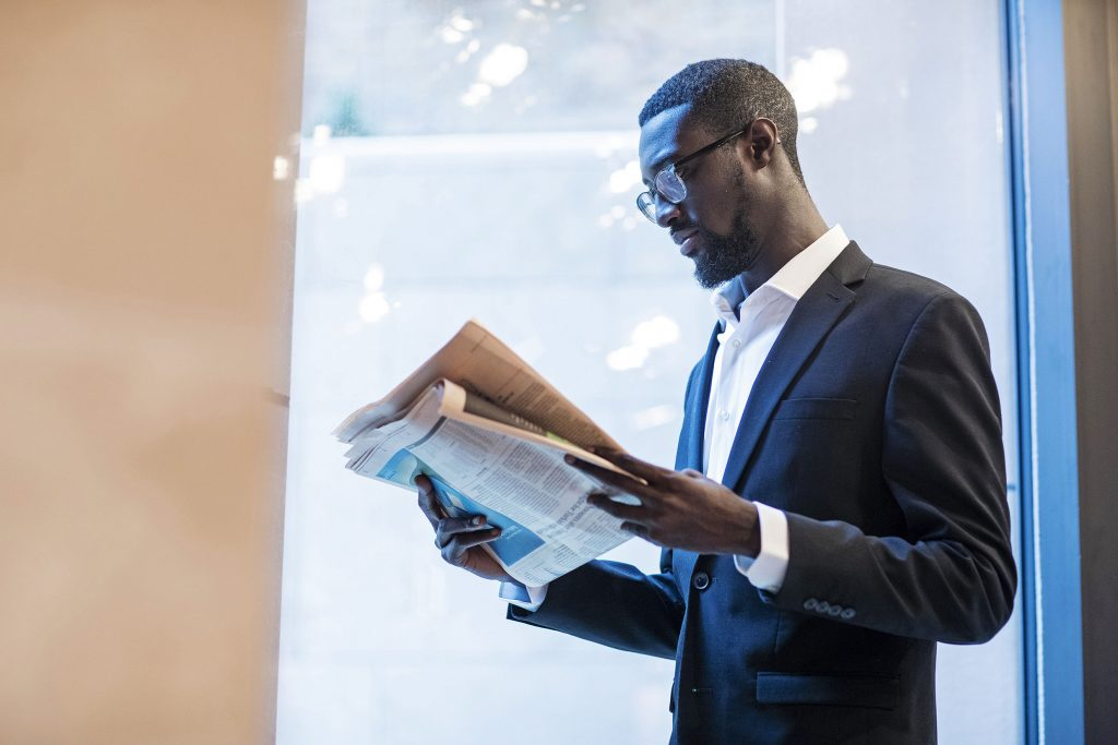 Todd Gyamfi reads the FT in The Mansion brand film